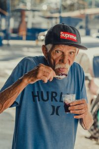 Elderly Man Eating Ice Cream